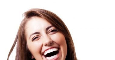 AI   Parkinson's News Today   Woman smiling and laughing