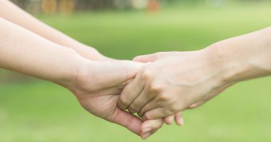 acupuncture for Parkinson's | Parkinson's News Today | two people holding hands