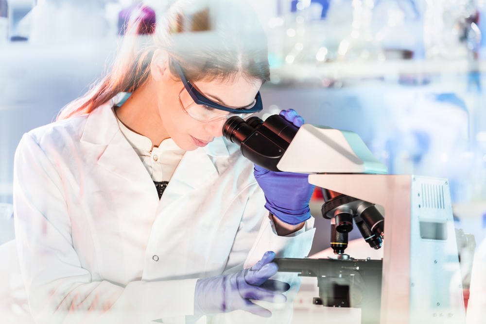 PIAS2 | Parkinson's News Today | Dementia research | Technician looking through microscope in laboratory