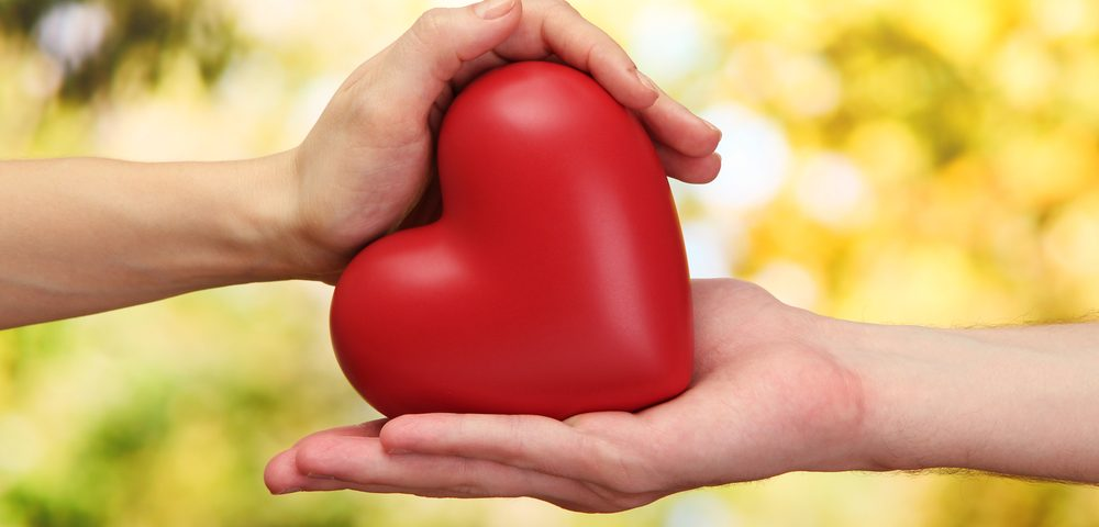 Parkinson's Foundation community grants | Parkinson's News Today | hands holding a bright red heart