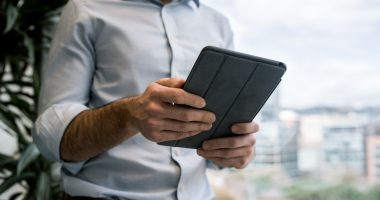 Technology allowing at-home care/Parkinson's News Today/person connecting on a portable device